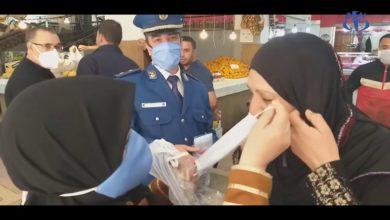 صورة توزيع الكمامات مجاناً على المواطنين