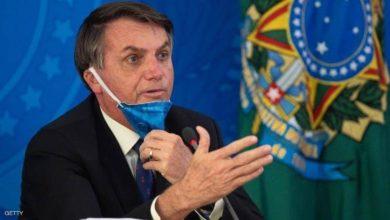 صورة الرئيس البرازيلي يهدّد بالانسحاب من منظمة الصحة العالمية